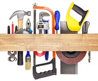 Carpentry background. Carpentry, construction hardware tools underneath the wood plank Royalty Free Stock Photo