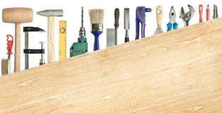 Carpentry background. Carpentry, construction background. Tools underneath the wood plank Royalty Free Stock Photo