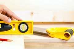 Carpentry: carpenter using a bubble level Royalty Free Stock Images