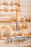 Carpentry chisel and wooden figuire Stock Image