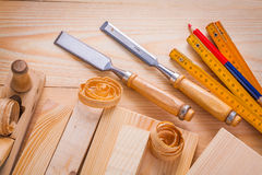 Carpentry chisels wooden boards meter pencil Stock Photo