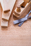 Carpentry chisels woodworkers plane and planks on Stock Photography