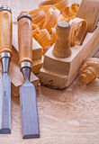 Carpentry chisels woodworkers plane shavings on Stock Images