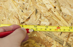 Carpentry concept. Close up of measure tape and pencil Royalty Free Stock Photo