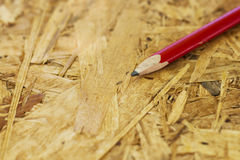 Carpentry concept. Close up of pencil on wooden board Royalty Free Stock Photos