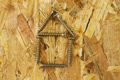 Carpentry concept. Close up of screws on wooden board Stock Images