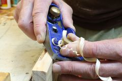 Carpentry edging plane with shaving Stock Photos