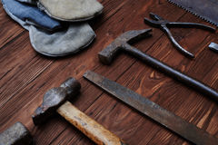 Carpentry hand tools composition over grunge wooden background Royalty Free Stock Photography