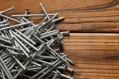 Carpentry Nails. Galvanized carpentry nails on wood Royalty Free Stock Photo