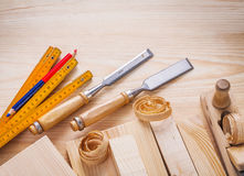 Carpentry set joiners chisels wooden meter pencil. Shavings and boards Royalty Free Stock Photography