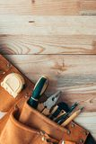 Carpentry tool belt on woodwork workshop desk, top view stock image