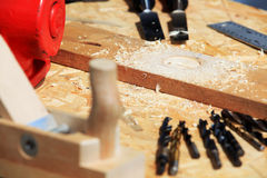 Carpentry tools. On work bench surface with wood shavings Royalty Free Stock Images