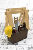 Carpentry tools. Closeup image of miniature carpentry tools sitting on a set of blueprints royalty free stock image