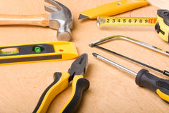 Carpentry tools. On wooden background Royalty Free Stock Image