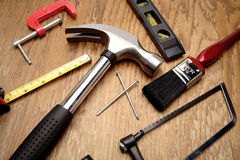 Carpentry Tools. Common carpentry tools on a wooden surface Stock Image