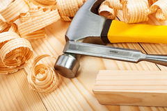 Carpentry tools. On boards wiuth wooden chips stock image