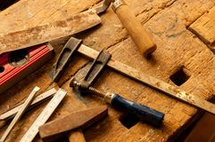 Carpentry tools. Carpentry tools on old oak workbench Stock Images