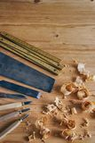 Carpentry tools concept. Vintage equipment for working with wood. Saw and chisel on wooden table with shavings Royalty Free Stock Images