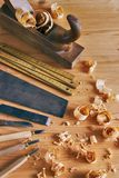 Carpentry tools concept. Vintage equipment for working with wood. planer, saw and chisel on wooden table with shavings Stock Images