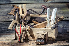 Carpentry tools and diagrams in an old workshop. On old wooden table Royalty Free Stock Photo