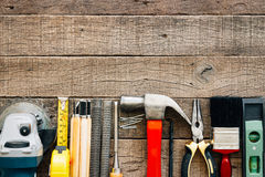 Carpentry tools equipment on grain wood royalty free stock images