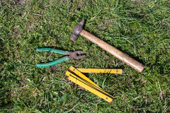 Carpentry tools on grass Stock Image