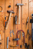 Carpentry tools hanging on the wall Stock Photography