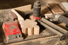 Carpentry tools - nailing gun and sander on workbench Royalty Free Stock Images