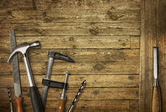 Carpentry tools old wood. Carpentry hand tools set on old wooden background stock images