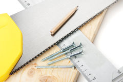 Carpentry tools and plank Royalty Free Stock Photo