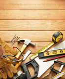Carpentry tools. Variety of carpentry tools on wood planks with copy space royalty free stock images