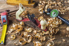 Carpentry tools. Various carpentry tools and planer shavings on the workbench among Stock Photos