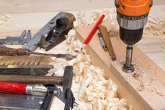 Carpentry tools and wood shavings in the workshop Royalty Free Stock Photo