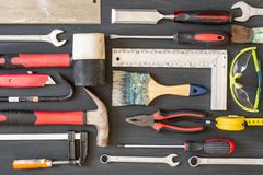 Carpentry tools on wooden background. Copy space for inscription stock images