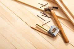 Carpentry tools on wooden background. Top view. Empty space for Your text Royalty Free Stock Photography