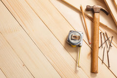 Carpentry tools on wooden background Royalty Free Stock Photos