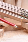 Carpentry tools with wooden bricks on work table stock photos