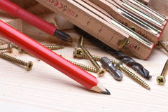Carpentry tools with wooden bricks on work table royalty free stock images