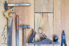 Carpentry tools on a wooden table top.  Stock Images