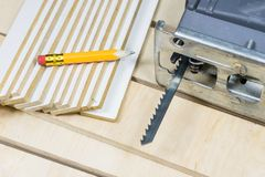 Carpentry tools on a wooden workshop table. Saw and other carpen Stock Photography