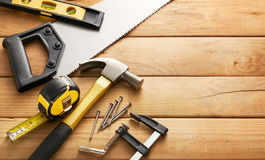 Carpentry. Variety of carpentry tools on wood planks with copy space royalty free stock image
