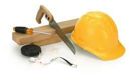 Carpentry on white. Hard hat, saw, 2x4, screwdriver on white Stock Image