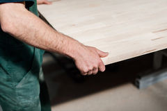 Carpentry worker in a manufacture production Stock Images