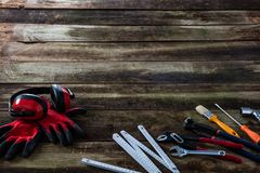 Carpentry workman professional hardware tools on old wood for house background royalty free stock image
