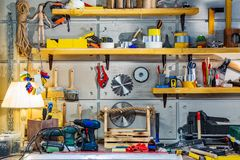 Carpentry workshop equipped with the necessary tools. Hanging on the wall stock photo