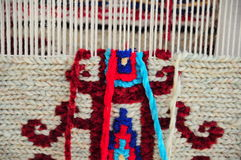 Carpet. Handmade carpet with red, blue and white ropes Royalty Free Stock Photos