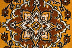 Carpet. Fragment of brown carpet with pattern royalty free stock photos