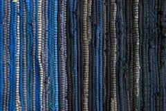 Carpet background. Blue and black cotton carpet Stock Image