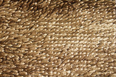 Carpet background. Closeup of an gold brown carpet background Royalty Free Stock Photography