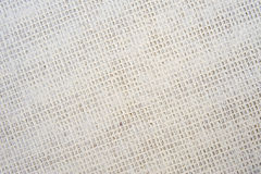 Carpet backing. A vertical macro  image of the polypropylene woven backing on a modern carpet Royalty Free Stock Image